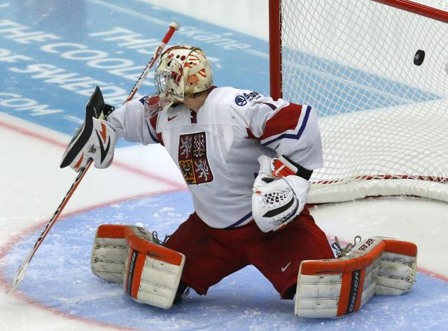 Czech Republic's goalie Marek Langhammer lets in a goal by Canada's Jonathan Drouin, not seen, during the third period of their IIHF World Junior Championship ice hockey game in Malmo, Sweden, December 28, 2013. REUTERS/Alexander Demianchuk (SWEDEN - Tags: SPORT ICE HOCKEY)