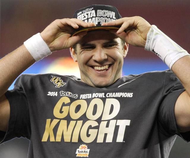 Central Florida quarterback Blake Bortles puts on his champions hat after the Fiesta Bowl NCAA college football game against Baylor, Wednesday, Jan. 1, 2014, in Glendale, Ariz. Central Florida won 52-42. (AP Photo/Rick Scuteri)
