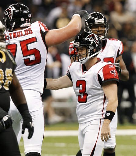 Atlanta Falcons' Matt Bryant (3) is congratulated by guard Garrett Reynolds (75) after he kicked a field goal in the first quarter of an NFL football game against the New Orleans Saints in New Orleans, Monday, Dec. 26, 2011. (AP Photo/Gerald Herbert)