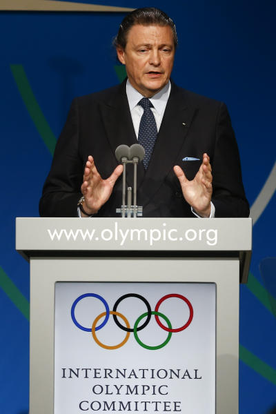 Puerto Rican banker Richard Carrion, member of the International Olympic Committee (IOC) and IOC presidential candidate, speaks at a report session during the 125th IOC session in Buenos Aires, Argentina, Monday, Sept. 9, 2013. (AP Photo/Victor R. Caivano)