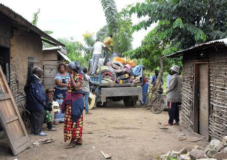 Civilians prepare to flee from their home following an attack by suspected Islamist rebels who killed at least 11 civilians in Beni, Democratic Republic of Congo, March 28, 2018. REUTERS/Stringer