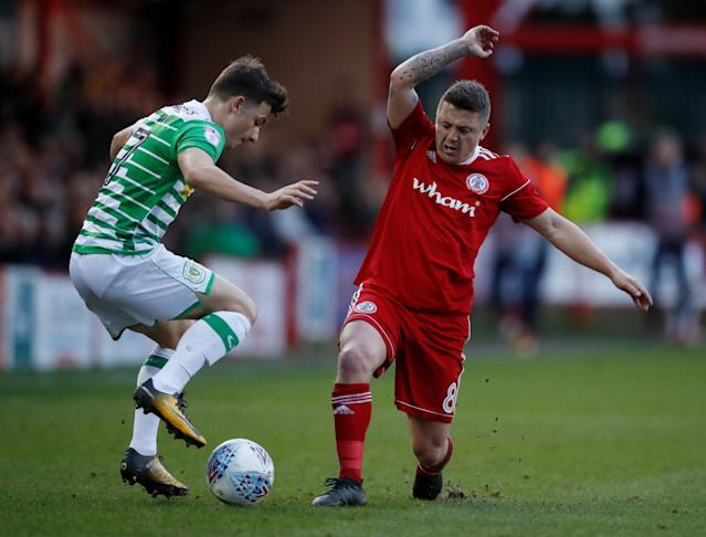 "Soccer Football - League Two - Accrington Stanley vs Yeovil Town - Wham Stadium, Accrington, Britain - April 17, 2018 Accrington Town's Scott Brown in action with Yeovil Town's Otis Khan Action Images/Carl Recine EDITORIAL USE ONLY. No use with unauthorized audio, video, data, fixture lists, club/league logos or ""live"" services. Online in-match use limited to 75 images, no video emulation. No use in betting, games or single club/league/player publications. Please contact your account representative for further details."