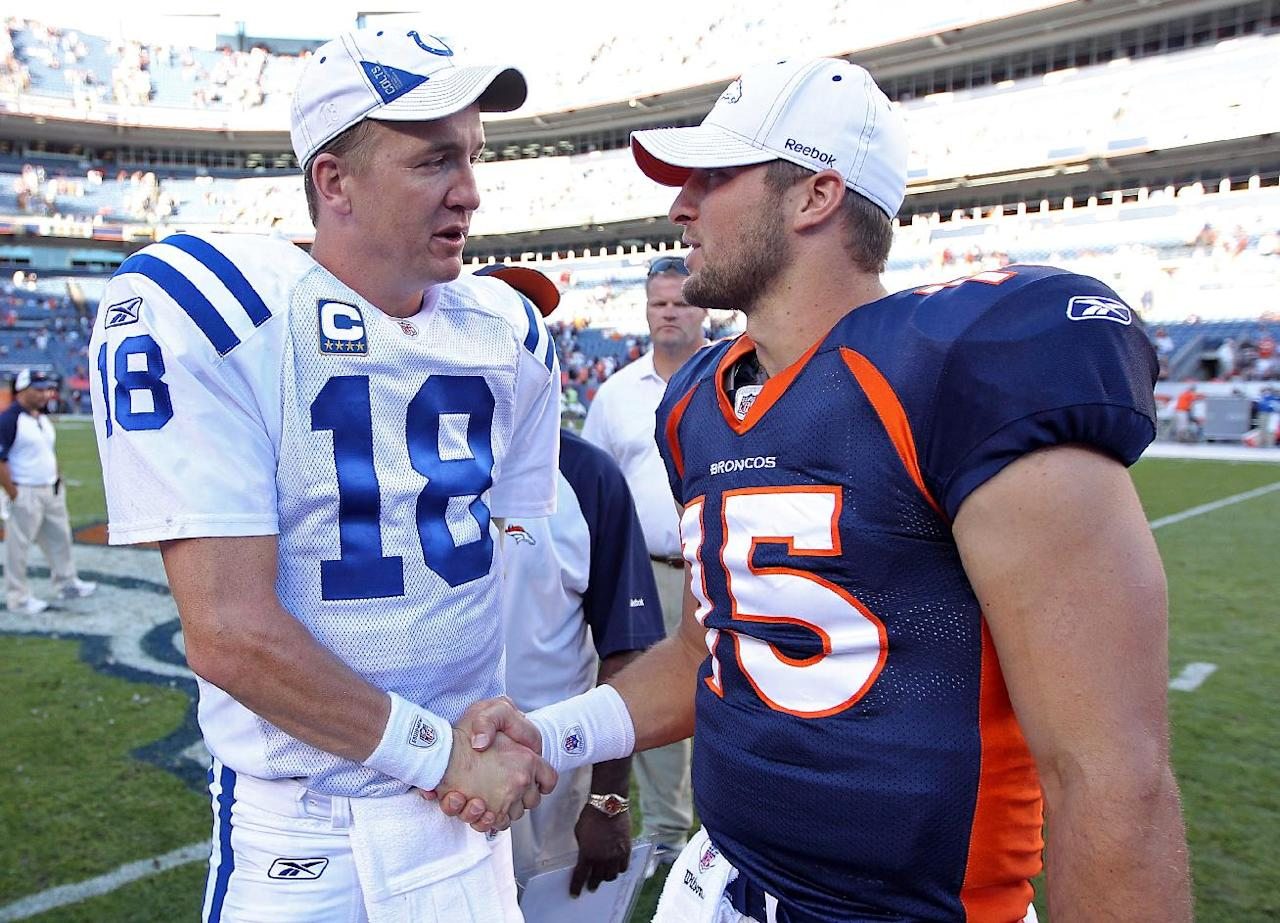 FILE - In this Sept. 26, 2010 file photo, Indianapolis Colts quarterback Peyton Manning (18) greets Denver Broncos quarterback Tim Tebow (15) at an NFL game, in Denver. Manning is negotiating to join the Broncos, ESPN reported Monday, March 19, 2012. Citing anonymous sources, ESPN said that the four-time MVP has instructed agent Tom Condon to negotiate the details of a deal with Denver. (AP Photo/Greg Trott) MANDATORY CREDIT MAGS OUT TV OUT