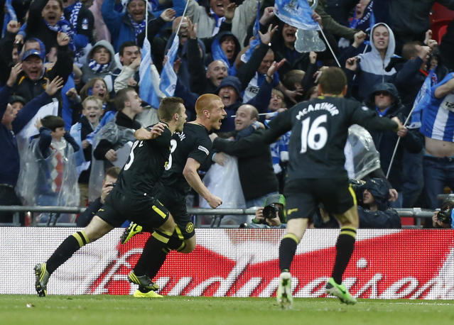Wigan Athletic's Ben Watson, center, celebrates his goal against Manchester City with teammates during their English FA Cup final soccer match at Wembley Stadium, London, Saturday, May 11, 2013. (AP Photo/Jon Super)