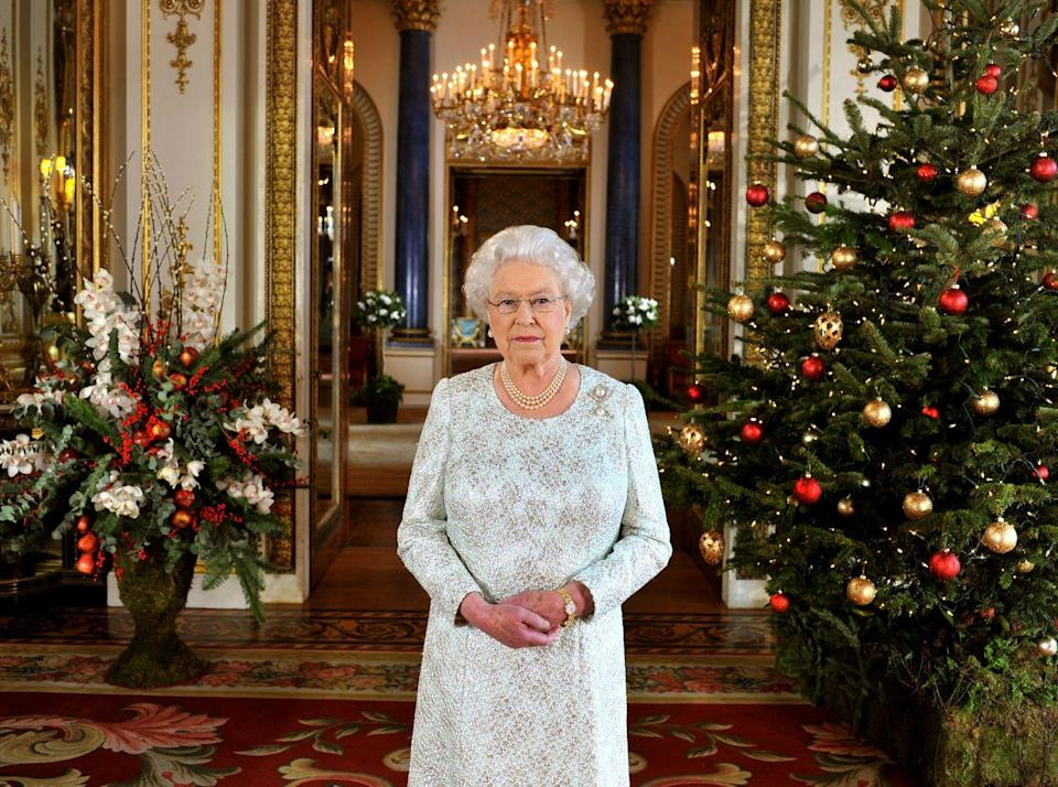 <p>For her 2012 Christmas message, Queen Elizabeth matched her jewelry the decorations, and sported a gold watch.</p>