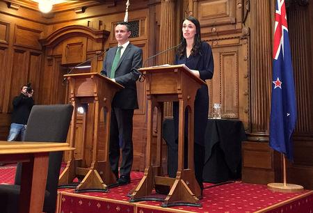 FILE PHOTO: New Zealand's Prime Minister-designate Jacinda Ardern speaks as she stands next to New Zealand Green Party leader James Shaw in Wellington, New Zealand, October 24, 2017. REUTERS/Nicolaci da Costa/File Photo