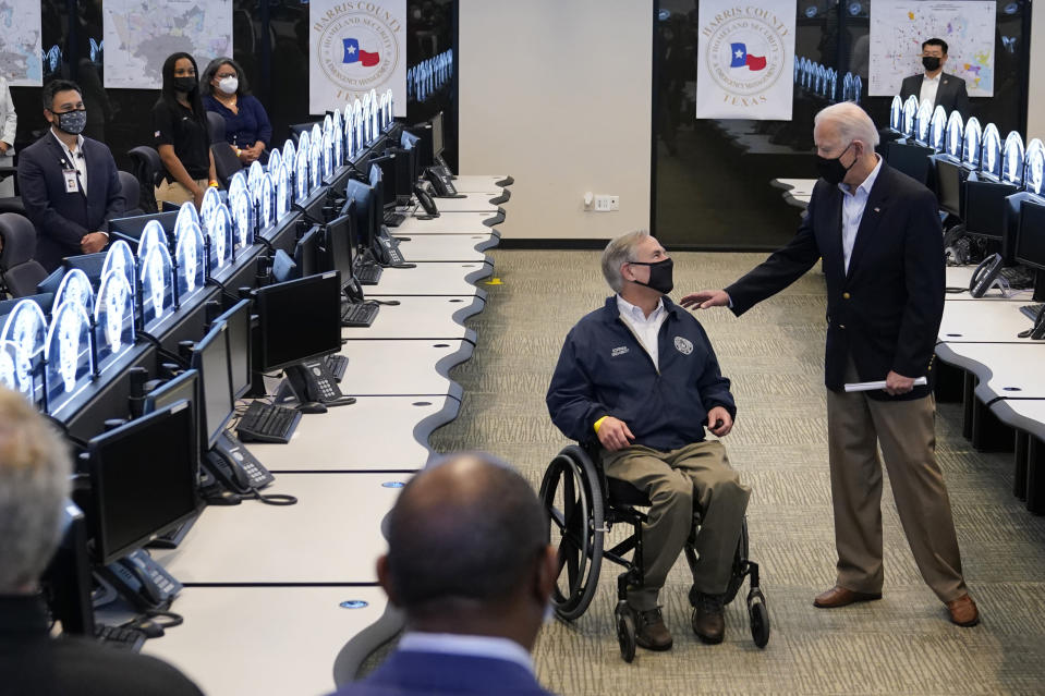 President Joe Biden talks with Texas Gov. Greg Abbott as they tour the Harris County Emergency Operations Center, Friday, Feb. 26, 2021, in Houston. (AP Photo/Patrick Semansky)