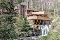 "<p><a href=""https://fallingwater.org/"" rel=""nofollow noopener"" target=""_blank"" data-ylk=""slk:Fallingwater"" class=""link rapid-noclick-resp"">Fallingwater </a>stands as one of iconic architect Frank Lloyd Wright's most celebrated projects for its innate connection to nature and forward-thinking design. The extraordinary house in Mill Run, Pennsylvania, served as the weekend getaway for the Kaufmann family, who originally envisioned it to be placed across from the waterfall. </p><p>Wright, inspired by traditional Japanese architecture, instead drew up plans for the house to be over the waterfall and positioned to look as though it was one with the natural rock formations. In 1976, the home was named a National Historic Landmark, and it remains one of the most popular destinations for architectural lovers in the world.</p>"