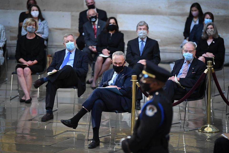 <p>Senator Chuck Schumer(C) (D-NY) attends the memorial service for Rep. John Lewis, D-GA, as he lies in state in the Rotunda of the US Capitol in Washington, DC, on July 27, 2020.</p>