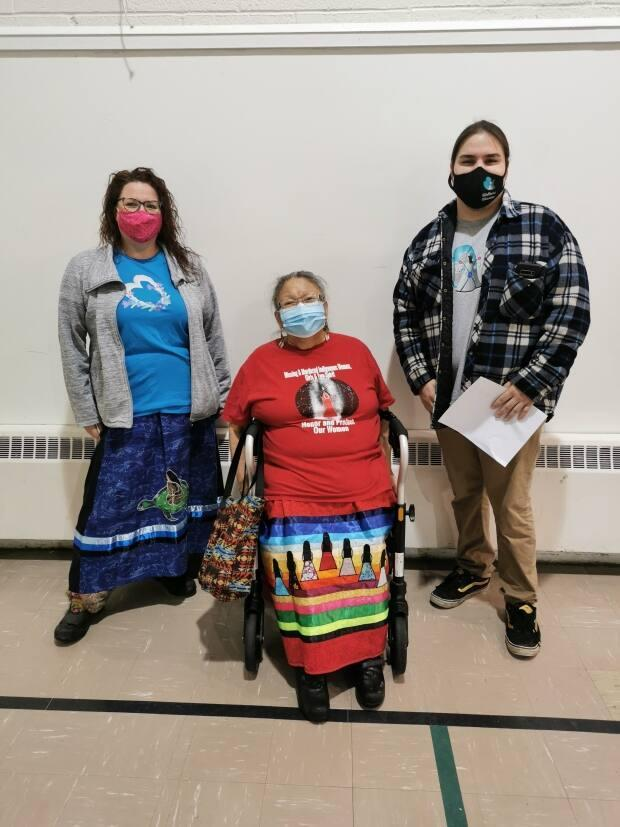 Research director Dr. JoLee Sasakamoose from the Wellness Wheel, Kookum Lillian Piapot and wellness warrior Darian Agecoutay at an elder immunization clinic on March 3, 2021. (Cody Lloyd, Wellness Wheel - image credit)