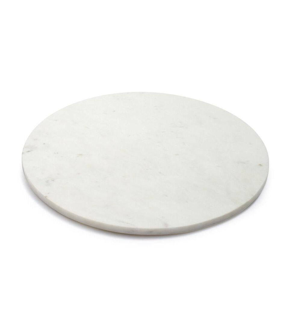 """A house isn't a home without a cheese board. This versatile marble serving platter from Sur La Table is a happy hour essential and will last for years to come. $20, Sur La Table. <a href=""""https://www.surlatable.com/round-marble-serving-board/PRO-1241694.html?cgid=cat8140467#start=5"""" rel=""""nofollow noopener"""" target=""""_blank"""" data-ylk=""""slk:Get it now!"""" class=""""link rapid-noclick-resp"""">Get it now!</a>"""