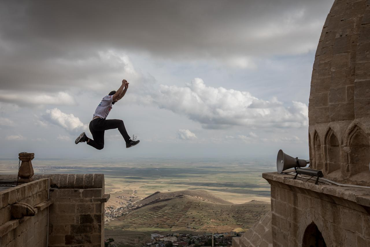 <p>Competitors warm up ahead of the start of the freestyle category during the second round of the World Parkour Championships on May 12, 2018 in Mardin, Turkey. (Photo from Chris McGrath/Getty Images) </p>