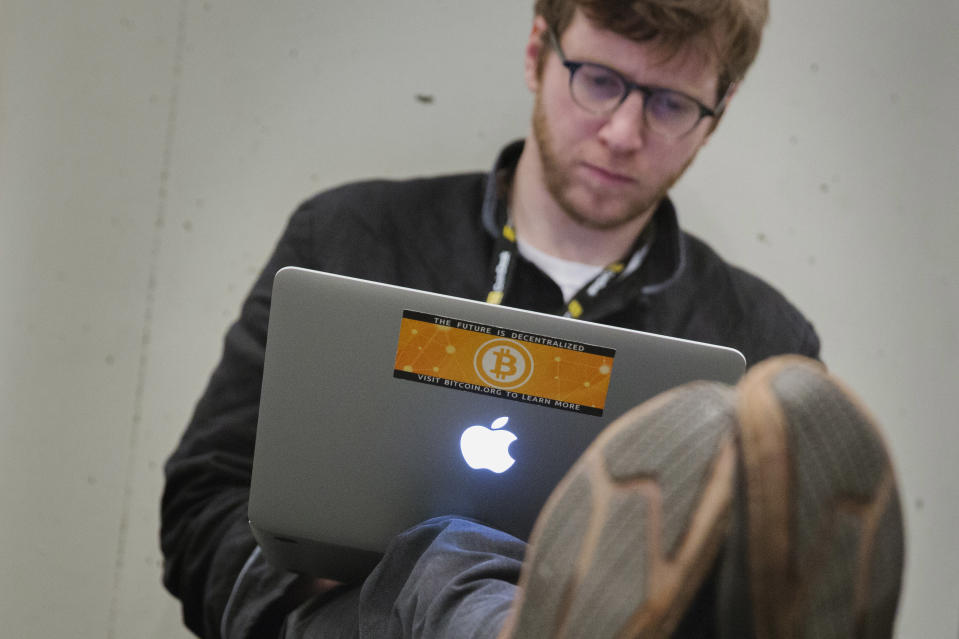 A Bitcoin themed sticker is seen on a man's computer during the Inside Bitcoins: The Future of Virtual Currency Conference in New York April 8, 2014. REUTERS/Lucas Jackson (UNITED STATES - Tags: BUSINESS SCIENCE TECHNOLOGY)