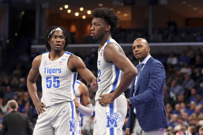 Memphis' James Wiseman (32), Precious Achiuwa (55) talk during a break during the second half of an NCAA college basketball game against Illinois-Chicago, Friday, Nov. 8, 2019, in Memphis, Tenn. (AP Photo/Karen Pulfer Focht)