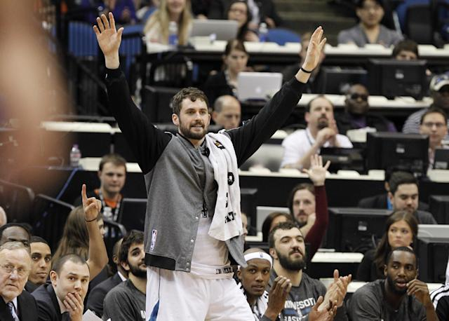 Minnesota Timberwolves forward Kevin Love cheers his teammates from the bench during the fourth quarter of an NBA basketball game against the Los Angeles Lakers in Minneapolis, Friday, March 28, 2014. The Timberwolves won 143-107. (AP Photo/Ann Heisenfelt)