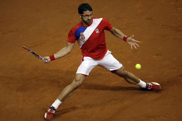 Serbia's Janko Tipsarevic returns the ball to Canada's Vasek Pospisil during their Davis Cup semifinals tennis match in Belgrade, Serbia, Sunday, Sept. 15, 2013. (AP Photo/ Marko Drobnjakovic)