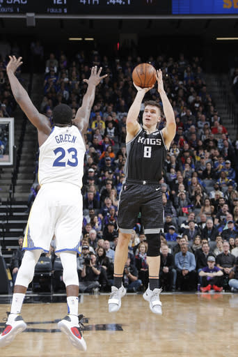 SACRAMENTO, CA - JANUARY 5: Bogdan Bogdanovic #8 of the Sacramento Kings shoots the ball against the Golden State Warriors on January 5, 2019 at Golden 1 Center in Sacramento, California. (Photo by Rocky Widner/NBAE via Getty Images)