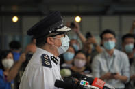 Chris Tang, commissioner of the Hong Kong Police Force, speaks to the media during a press conference in Hong Kong, Wednesday, May 12, 2021. A top Hong Kong national security officer was reportedly caught up in a raid on an unlicensed massage business, and will face a police force investigation into the alleged misconduct. Hong Kong's Director of National Security Frederic Choi has since been put on leave after the incident, according to Tang. (AP Photo/Kin Cheung)