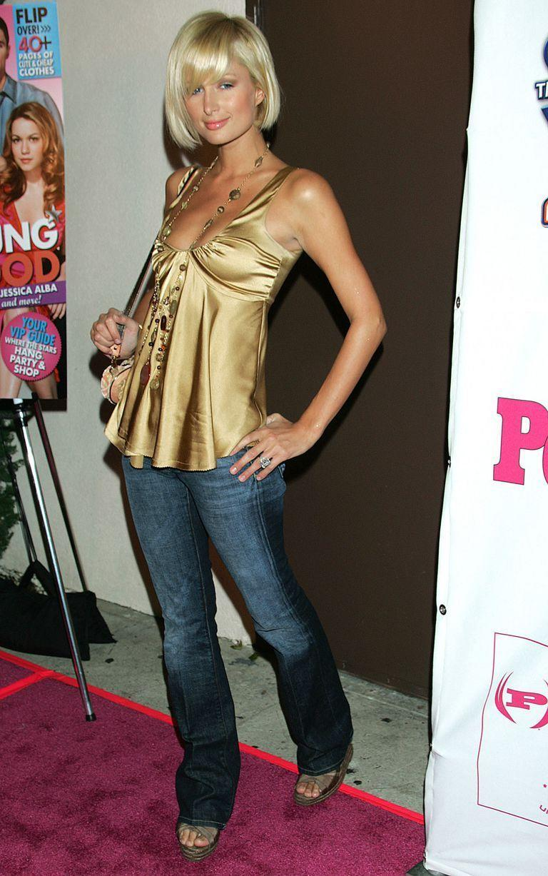 <p>Paris Hilton pairs her denim with what else (in 2005): a Going Out Top.</p>