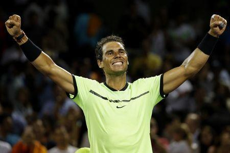 Mar 29, 2017; Miami, FL, USA; Rafael Nadal of Spain celebrates after his match against Jack Sock of the United States (not pictured) on day nine of the 2017 Miami Open at Crandon Park Tennis Center. Nadal won 6-2, 6-3. Mandatory Credit: Geoff Burke-USA TODAY Sports0