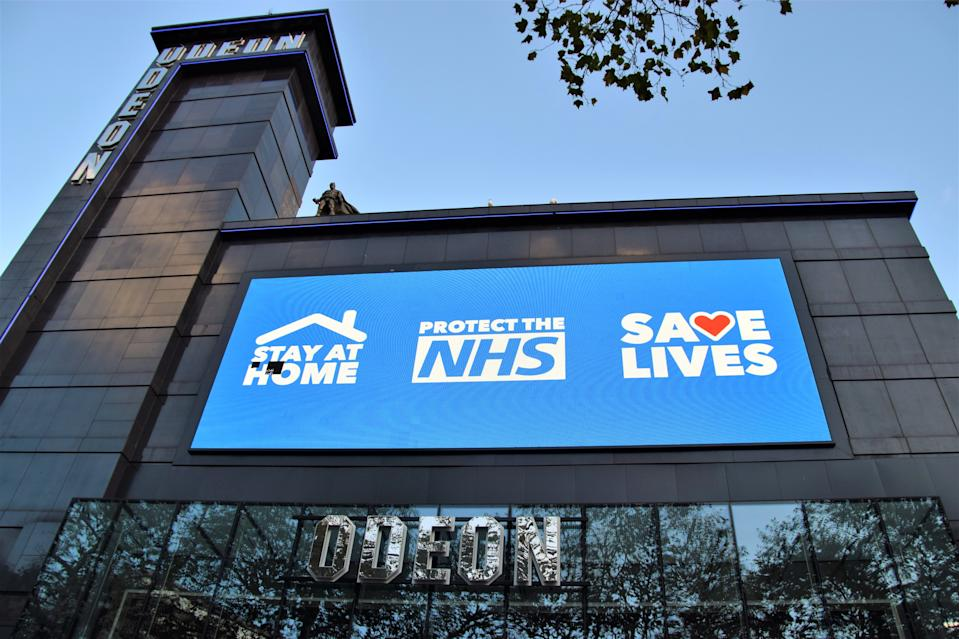 LONDON, UNITED KINGDOM - 2020/11/10: Stay at Home, Protect The NHS, Save Lives sign seen at the closed Odeon cinema in Leicester square. Most shops, restaurants and businesses have closed as the second month-long nationwide Covid 19 lockdown begins in England. (Photo by Vuk Valcic/SOPA Images/LightRocket via Getty Images)