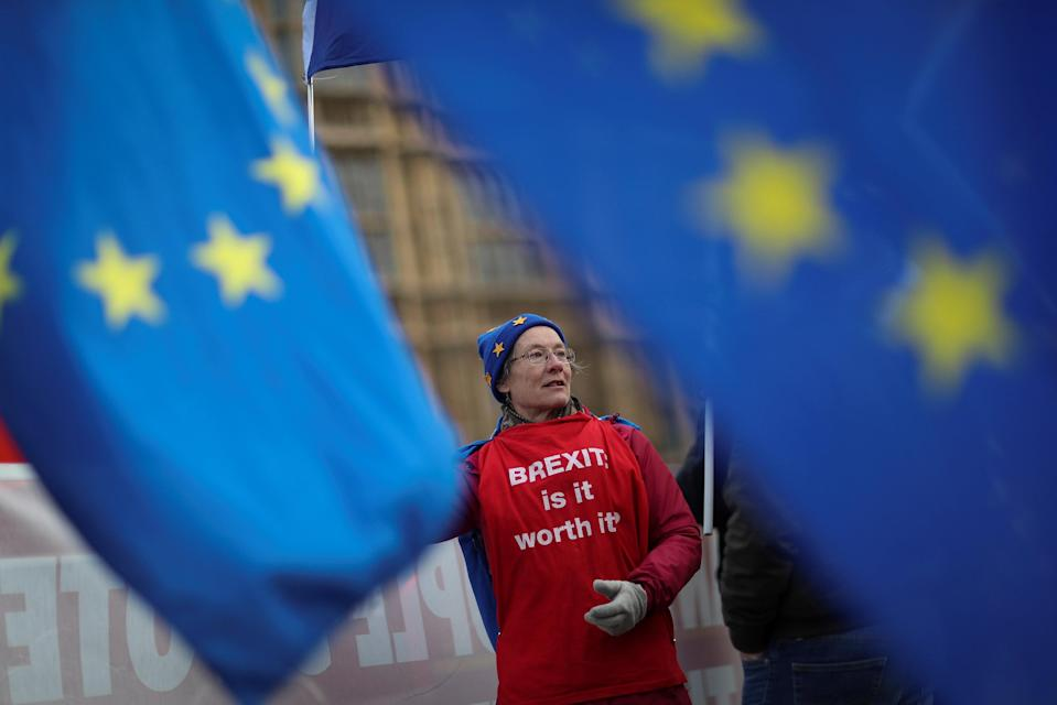 An anti-Brexit protester waves a flag outside the Houses of Parliament in London, Britain January 11, 2019. Photo: Reuters/Simon Dawson/File Photo
