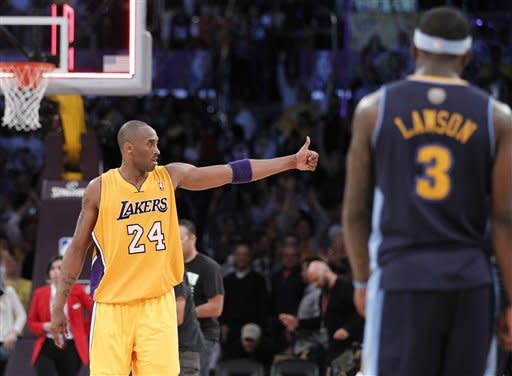 Los Angeles Lakers' Kobe Bryant celebrates their win a NBA first-round playoff basketball game in Los Angeles, Tuesday, May 1, 2012. The Lakers won 104-100. (AP Photo/Chris Carlson)