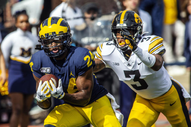 FILE - In this Oct. 5, 2019, file photo, Michigan defensive back Lavert Hill (24) intercepts a pass intended for Iowa wide receiver Tyrone Tracy, Jr. (3) in the second quarter of an NCAA college football game, in Ann Arbor, Mich. Hill was selected to The Associated Press All-Big Conference team, Wednesday, Dec. 11, 2019. (AP Photo/Tony Ding, File)