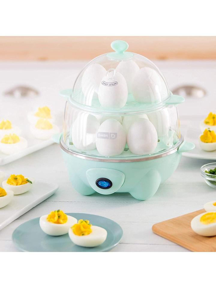"""<p>Whether you're making a big batch of eggs for a crowd or meal prepping for the coming week, this two-tiered egg cooker is more than up to the task. Essentially the same machine as Dash's original egg cooker, the Deluxe fits double the eggs, easily boiling a dozen jammy yolks, or poaching delicate whites with its one-touch button. The cooker also comes with trays to make individual omelets with custom fillings for weekday breakfasts or one big frittata for Sunday brunch. And if you want to venture beyond eggs, you can use the cooker to steam vegetables, dumplings, and seafood. </p> <p>The crowd-friendly egg cooker has earned itself a 4.4-star rating on Amazon, with over 2,700 reviews. Many users described how helpful it is for entertaining, especially when making delicious deviled eggs: """"This is so amazing,"""" <a href=""""https://www.amazon.com/gp/customer-reviews/R2WPVY69YDCEF2/ref=as_li_ss_tl?ie=UTF8&linkCode=ll2&tag=rsbesteggcookerskmacdonald0919-20&linkId=024bd8687d62ab3516702469bb033f68&language=en_US"""" target=""""_blank"""">raved a commenter</a>. """"I usually do 2 dozen boiled eggs at Christmas (I'm the one who has to do the deviled eggs), this made it so much easier. I was able to peel 2 dozen eggs in a matter of 16 minutes (that's 8 mins per 1 dozen) Where if I did it the old way it would've taken me a couple of hours.""""</p> <p><strong>To buy:</strong> $30; <a href=""""https://www.amazon.com/Dash-DEC012AQ-Deluxe-Rapid-Cooker/dp/B07GPF8CCZ/ref=as_li_ss_tl?ie=UTF8&linkCode=ll1&tag=rsbesteggcookerskmacdonald0919-20&linkId=6f39a1970d933871e63d4511e6a043d3&language=en_US"""" target=""""_blank"""">amazon.com</a>.</p>"""