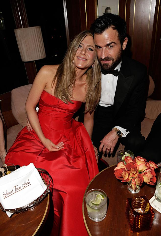 Jennifer Anistson and Justin Theroux attend the 2013 Vanity Fair Oscar Party hosted by Graydon Carter at Sunset Tower on February 24, 2013 in West Hollywood, California.