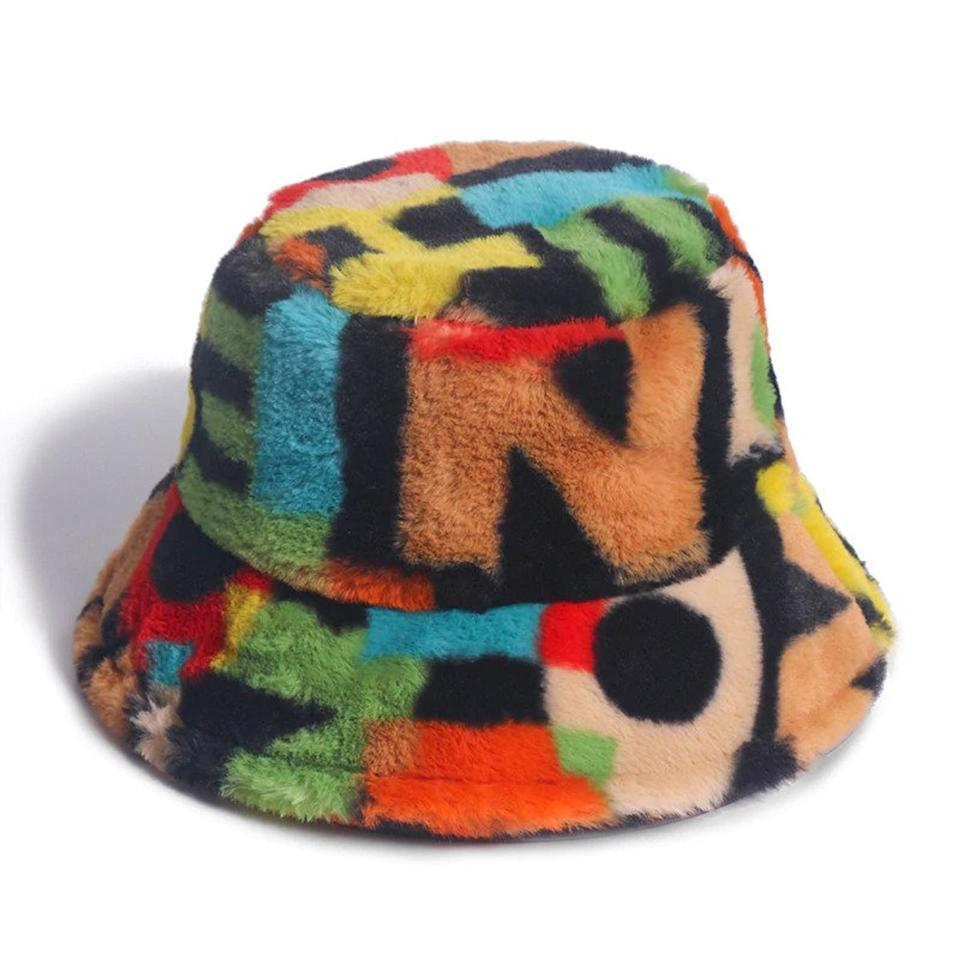 <p>Add a pop of color to your accessories with this <span>Alphabet Outdoor Multicolour Rainbow Faux Fur Bucket Hat</span> ($22, originally $24).</p>