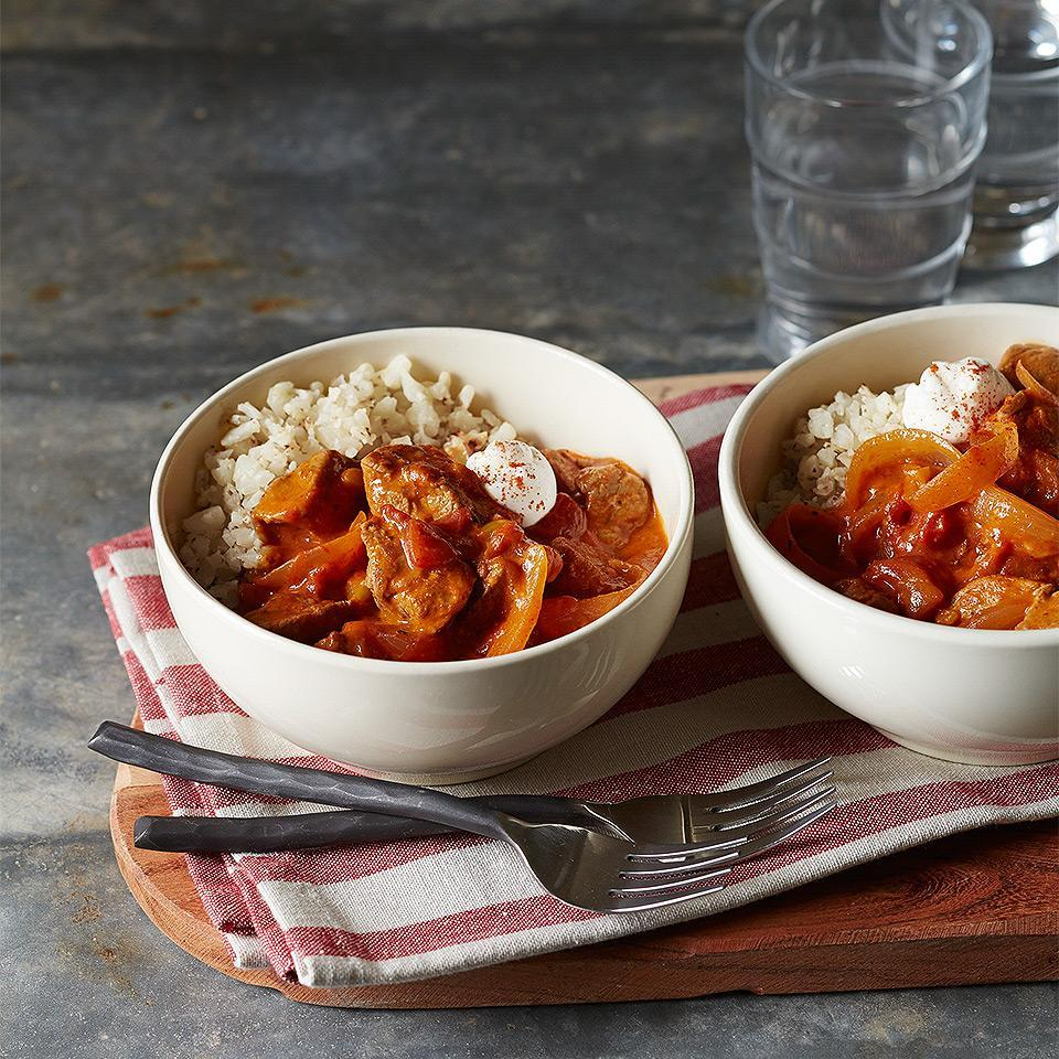 "<p>Cut carbs and calories by using cauliflower ""rice"" instead of regular rice in this 30-minute pork paprikash recipe. <a href=""http://www.eatingwell.com/recipe/269309/pork-paprikash-with-cauliflower-rice/"" rel=""nofollow noopener"" target=""_blank"" data-ylk=""slk:View recipe"" class=""link rapid-noclick-resp""> View recipe </a></p>"