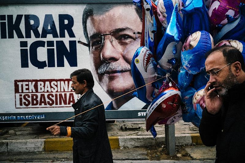 An election billboard of Turkish Prime Minister Ahmet Davutoglu during a Republic Day ceremony in Istanbul on October 29, 2015, ahead of November 1 general elections (AFP Photo/Dimitar Dilkoff)