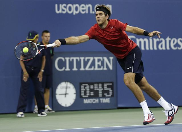 Juan Martin del Potro, of Argentina, stretches for a return to Novak Djokovic, of Serbia, during a quarterfinal at the U.S. Open tennis tournament, Thursday, Sept. 6, 2012, in New York. (AP Photo/Charles Krupa)