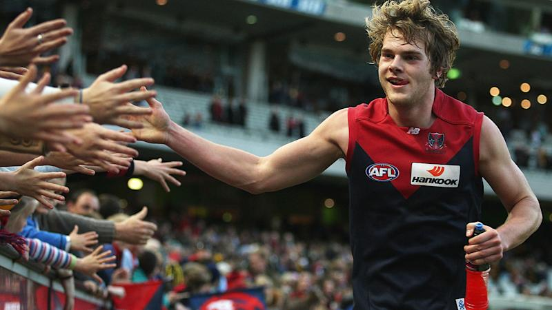 Jack Watts high-fives Melbourne Demons fans in 2011.