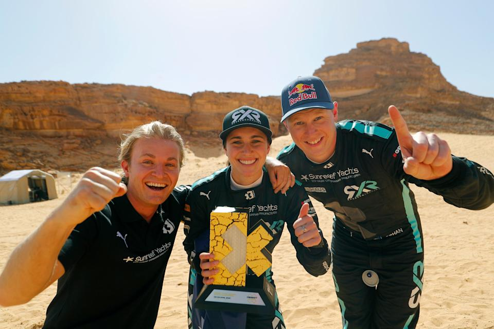 Nico Rosberg, Molly Taylor and Johan Kristoffersson celebrate (Extreme E)