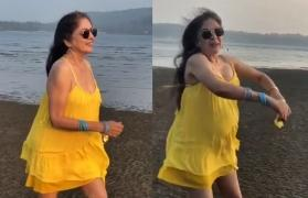 Better than Baywatch: Neena Gupta's slow-motion run on the beach in a mini yellow dress has left the internet gawking