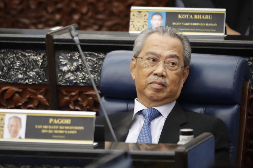 FILE - In this July 13, 2020, file photo, Malaysian Prime Minister Muhyiddin Yassin attends a parliament session at lower house in Kuala Lumpur, Malaysia. The key ally in Muhyiddin's coalition called for general elections on Friday, Oct. 30, 2020, to be held to establish a stable government once the coronavirus pandemic subsides, in a new snag to his fragile hold on power. (AP Photo/Vincent Thian, File)