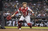 Los Angeles Angels catcher Max Stassi throws his gear after blocking the ball in the third inning during a baseball game against the Arizona Diamondbacks, Saturday, June 12, 2021, in Phoenix. (AP Photo/Rick Scuteri)