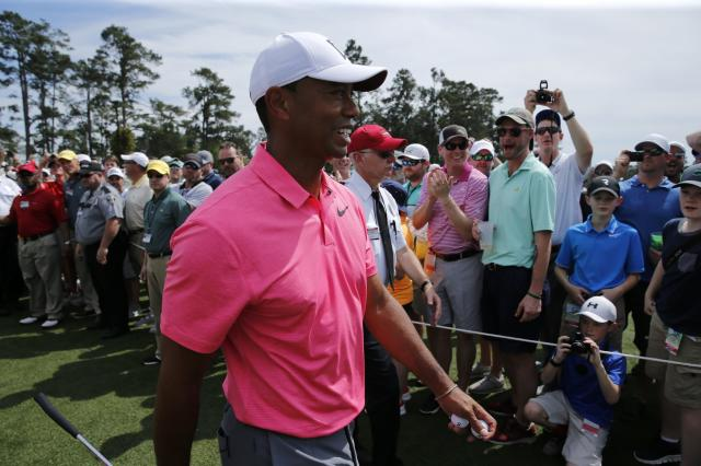 Tiger Woods of the U.S. walks past golf patrons to the first tee during practice for the 2018 Masters golf tournament at Augusta National Golf Club in Augusta, Georgia, U.S. April 2, 2018. REUTERS/Jonathan Ernst