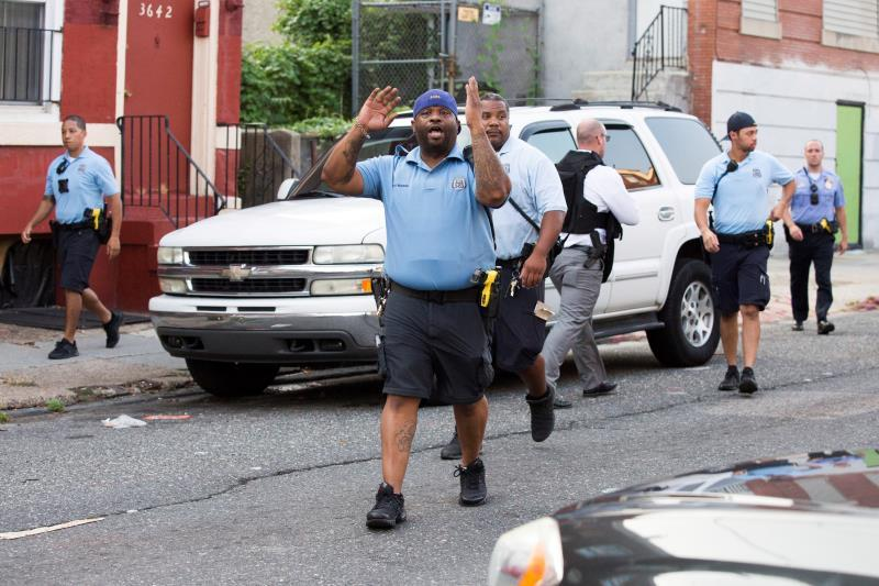Police block off the intersection of 15th Street and W Erie Avenue to contain the scene of an active police shooting in Philadelphia, Pennsylvania, USA, 14 August 2019. EFE/EPA/STRINGER
