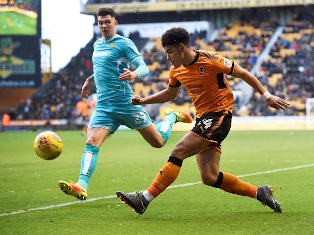 "Soccer Football - Championship - Wolverhampton Wanderers vs Burton Albion - Molineux Stadium, Wolverhampton, Britain - March 17, 2018 Wolves' Morgan Gibbs-White in action with Burton's Tomas Egert Action Images/Alan Walter EDITORIAL USE ONLY. No use with unauthorized audio, video, data, fixture lists, club/league logos or ""live"" services. Online in-match use limited to 75 images, no video emulation. No use in betting, games or single club/league/player publications. Please contact your account representative for further details."