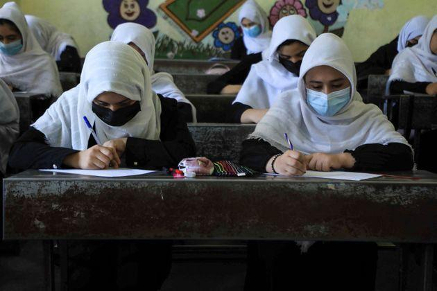 TOPSHOT - Schoolgirls attend class in Herat on August 17, 2021, following the Taliban stunning takeover of the country. (Photo by AREF KARIMI / AFP) (Photo by AREF KARIMI/AFP via Getty Images) (Photo: AREF KARIMI via Getty Images)