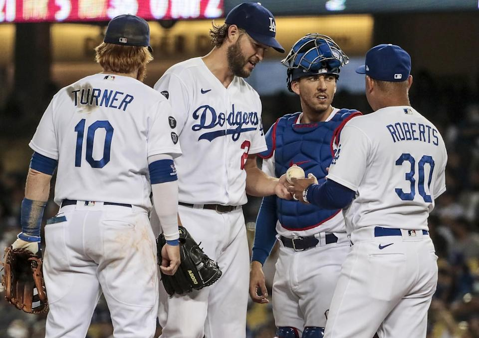 Dodgers manager Dave Roberts pulls pitcher Clayton Kershaw out of the game during the fifth inning Monday.