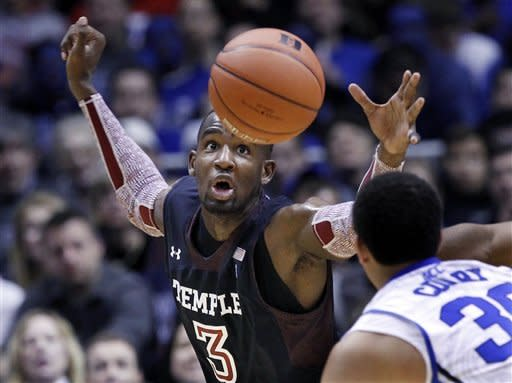 Temple forward Anthony Lee (3) grabs for the ball in front of Duke guard Seth Curry (30) during the first half of an NCAA college basketball game in in East Rutherford, N.J., Saturday, Dec. 8, 2012. (AP Photo/Mel Evans)