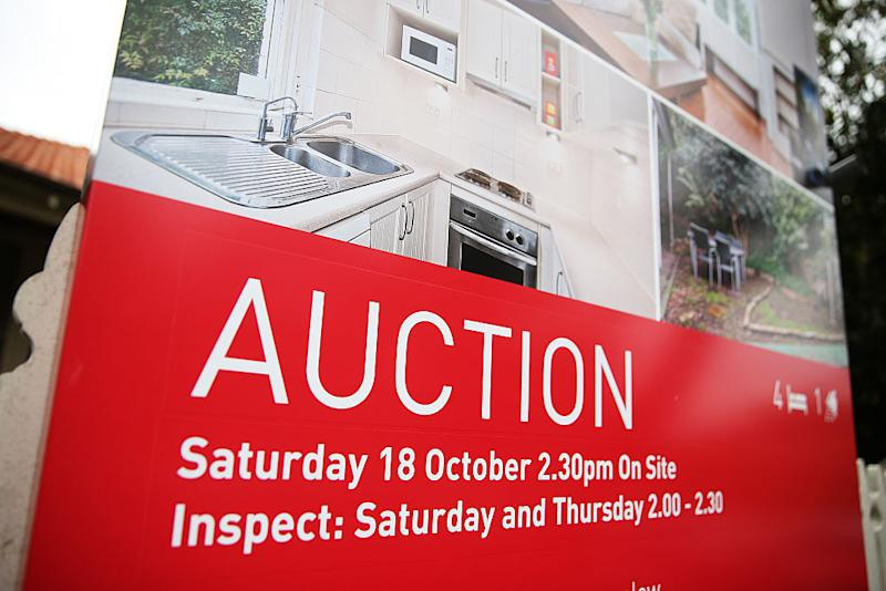 An auction sign stands on display outside a house in the suburb of Waverton in Sydney, Australia, on Saturday, Oct. 18, 2014.