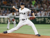 FILE - In this March 14, 2017, file photo, Japan starting pitcher Tomoyuki Sugano throws to a Cuba batter during the first inning of a second-round game at the World Baseball Classic in Tokyo. Host Japan is favored to win at the Tokyo Games. . Right-hander Tomoyuki Sugano, the reigning Central League MVP, heads a pitching staff that includes current Rookies of the Year Masato Morishita and Kaima Taira. (AP Photo/Toru Takahashi, File)