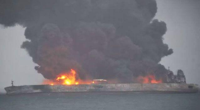 The oil tanker remains on fire and could sink off the coast of Shanghai. Source: People's Daily China
