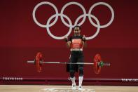 Loa Dika Toua of Papa New Guinea celebrates after a lift in the women's 49kg weightlifting event, at the 2020 Summer Olympics, Saturday, July 24, 2021, in Tokyo, Japan. (AP Photo/Luca Bruno)