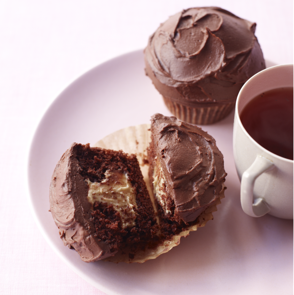 """<p>Use a pastry bag to easily pipe the luscious peanut butter filling to simple chocolate cupcakes. It's like your favorite Halloween candy in cupcake form!</p><p><em><a href=""""https://www.goodhousekeeping.com/food-recipes/a13332/peanut-butter-chocolate-cupcakes-recipe-122602/"""" rel=""""nofollow noopener"""" target=""""_blank"""" data-ylk=""""slk:Get the recipe for Peanut Butter and Chocolate Cupcakes »"""" class=""""link rapid-noclick-resp"""">Get the recipe for Peanut Butter and Chocolate Cupcakes »</a></em></p>"""